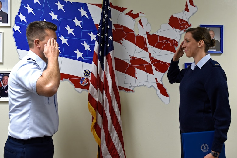 U.S. Air Force Lt. Col. Michael McCourt, 312th Training Squadron commander, salutes 2nd Lt. Catherine Doerger 315th Training Squadron student, after presenting her with the 315th TRS Officer Student of the Month Award at Brandenburg Hall on Goodfellow Air Force Base, Texas, Feb. 7, 2020. The 315th TRS's vision is to develop combat-ready intelligence, surveillance and reconnaissance professionals and promote an innovative squadron culture and identity unmatched across the U.S. Air Force. (U.S. Air Force photo by Senior Airman Zachary Chapman)