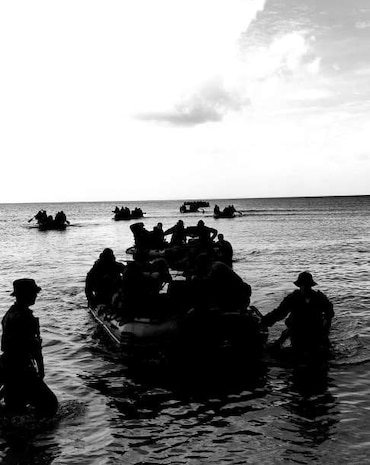 Company A, Battalion Landing Team 1/4, 31st Marine Expeditionary Unit, conducts an amphibious landing by small boat at Dadi Beach, Naval Base Guam, the same landing area that 1st Battalion, 4th Marines landing at during the liberation of Guam in World War II. Company A was tasked with being the Small Boat Raid Company of the 31st MEU during their deployment, and sent Marines to several weeks of rigorous instruction at Expeditionary Warfare Training Group –Pacific, in Coronado, California, to learn the skills needed to carry out this mission. Marines from Company A became highly skilled Small Boat Coxswains, Small Boat and Engine Mechanics, Scout Swimmers and Maritime Navigators, helping the Company become a successful clandestine small boat raid force during deployment.