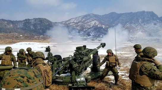 The U.S. Marines of Battery E, Battalion Landing Team, 1st Battalion, 4th Marines, 31st Marine Expeditionary Unit, conduct direct fire at Rodriguez Live Fire Complex (RLFC), Republic of Korea. Three Gun Crews competed, engaging in a target (a 10x40 ft CONEX box) at 1500 meters.