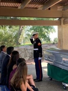 A Corporal from Weapons Company, 1st Battalion, 4th Marines, 1st Marine Regiment, conducts a memorial service for a veteran at Riverside National Cemetery, Riverside, California, Oct. 10, 2020. 1st Battalion, 4th Marines regularly participate in volunteer activities strengthening the bond between the USMC and the local community.