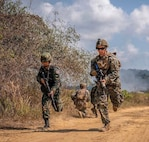 A Royal Thai Marine and a U.S. Marine of Combat Engineer Platoon, 1st Battalion, 4th Marines, 1st Marine Regiment, run back to an assault amphibious vehicle during Exercise Cobra Gold 2019 at Ban Chan Krem, Kingdown of Thailand, Feb. 19,2019. Combat Engineer Platoon worked hand in hand with the Royal Thai Marine Corps Combat Engineers to execute a live fire Bangalore breach in support of the Final Exercise. (U.S. Marine Corps photo by Staff Sgt. Matthew J.Bragg)