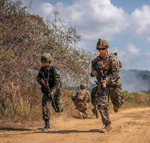 A Royal Thai Marine and a U.S. Marine of Combat Engineer Platoon, 1st Battalion, 4th Marines, 1st Marine Regiment, run back to an assault amphibious vehicle during Exercise Cobra Gold 2019 at Ban Chan Krem, Kingdown of Thailand, Feb. 19,2019.