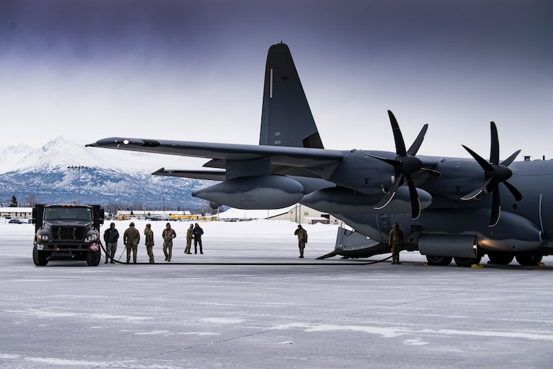 Airmen from Cannon Air Force Base's 27th Special Operations Logistics Readiness Squadron forward area refueling point team prepare for the operation of refueling two F-22 Raptor aircraft by an MC-130J Commando II aircraft during exercise Emerald Warrior at Joint Base Elmendorf-Richardson, Alaska, Jan. 29, 2020. This training marked the first time FARP capabilities were tested in an arctic environment. (U.S. Air Force Photo by Senior Airman Marcel Williams)
