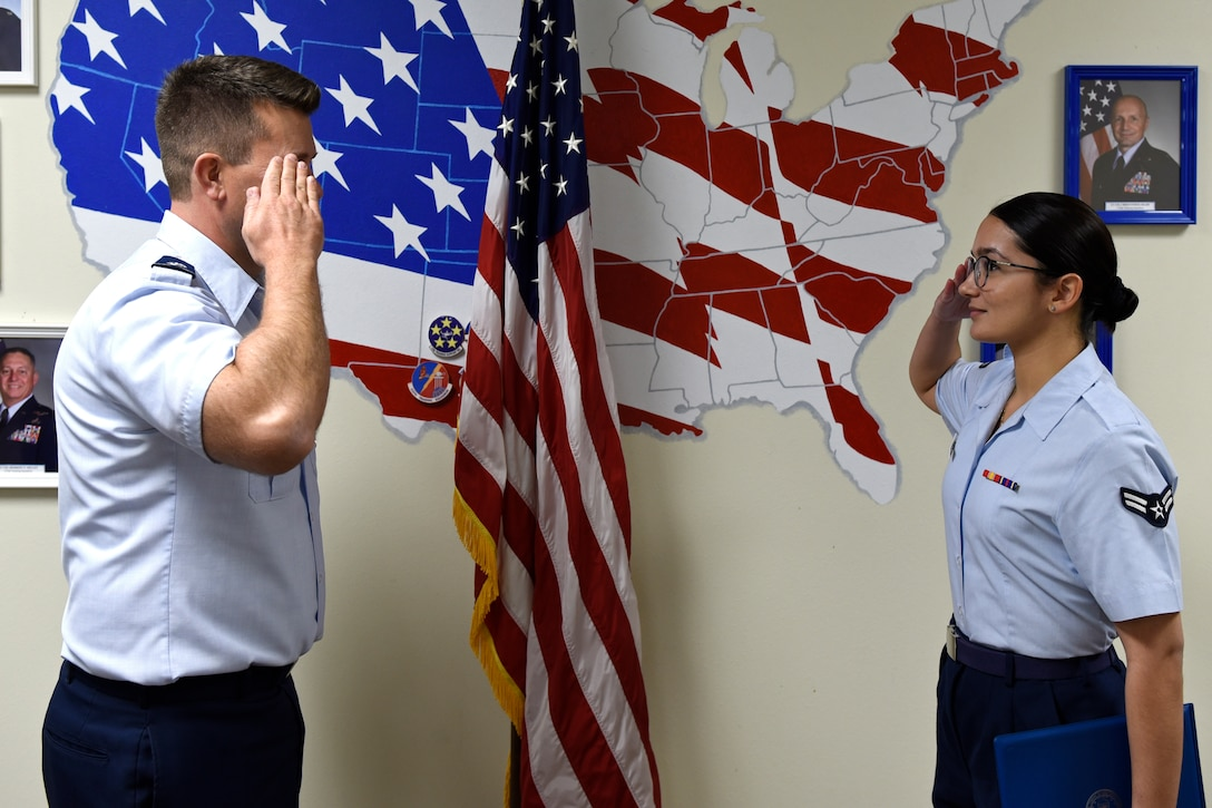 U.S. Air Force Lt. Col. Michael McCourt, 312th Training Squadron commander, salutes Airman 1st Class Amanda Garcia Lazcano, 315th Training Squadron student, after presenting her the 315th TRS Student of the Month award at Brandenburg Hall on Goodfellow Air Force Base, Texas, Feb. 7, 2020. The 315th TRS's vision is to develop combat-ready intelligence, surveillance and reconnaissance professionals and promote an innovative squadron culture. (U.S. Air Force photo by Senior Airman Zachary Chapman)