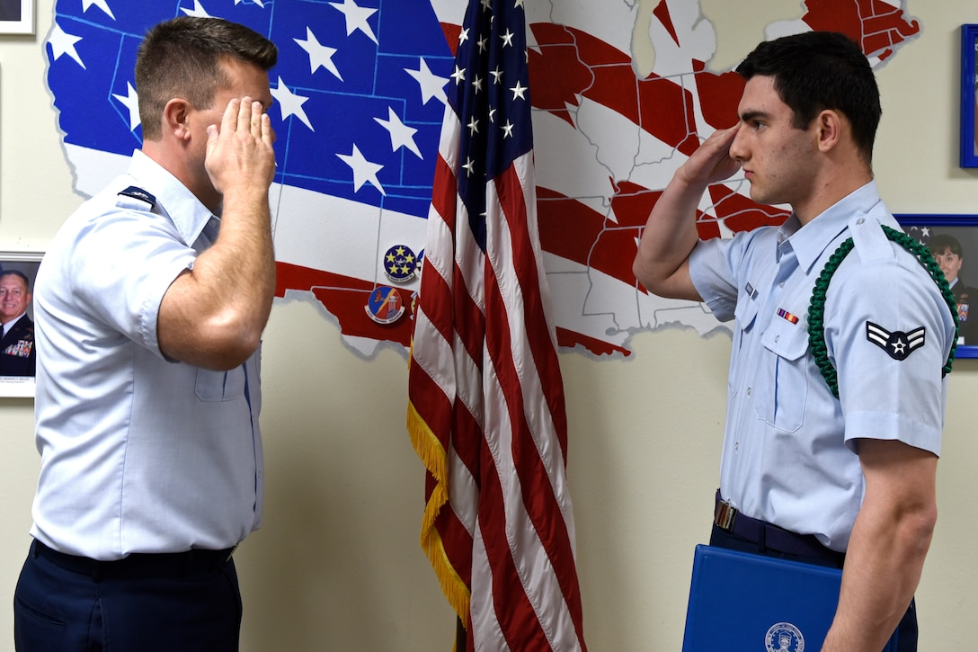 U.S. Air Force Lt. Col. Michael McCourt, 312th Training Squadron commander, salutes Airman 1st Class Nicolas Smaracheck, 315th Training Squadron student, after presenting him with the 17th Training Group Rope of the Month award at Brandenburg Hall on Goodfellow Air Force Base, Texas, Feb. 7, 2020. The green rope is the first of the leadership ropes, they are key players in keeping the order of a detachment. (U.S. Air Force photo by Airman 1st Class Zachary Chapman)
