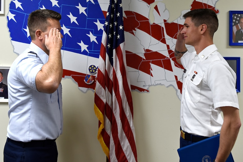 U.S. Air Force Lt. Col. Michael McCourt, 312th Training Squadron commander, salutes U.S. Army Specialist Coleton Saunders, 169th Engineer Battalion student, after presenting him with the 312th TRS Student of the Month Award at Brandenburg Hall on Goodfellow Air Force Base, Texas, Feb. 7, 2020.  The 312th TRS's mission is to provide Department of Defense and international customers with mission ready fire protection and special instruments graduates and provide mission support for the Air Force Technical Applications Center. (U.S. Air Force photo by Senior Airman Zachary Chapman)