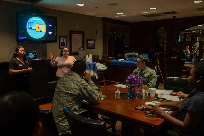 Photo of a 23d FSS member discussing upcoming events during a focus.