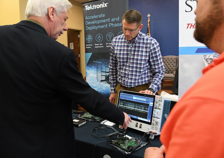 Randal Blanchard, 85th Engineering Installation Squadron electronics engineer, asks Larry Shemetulskis, Tektronix southeast U.S. channel manager, questions about the operations of an oscilloscope, which is used for analyzing electromagnetic signals, during the Annual Keesler Air Force Base Tech Expo inside the Bay Breeze Event Center at Keesler Air Force Base, Mississippi, Feb. 11, 2020. The expo, hosted by the 81st Communications Squadron, was held to introduce military members to the latest in technological advancements to bolster the Air Force�s capabilities in national defense. (U.S. Air Force photo by Kemberly Groue)