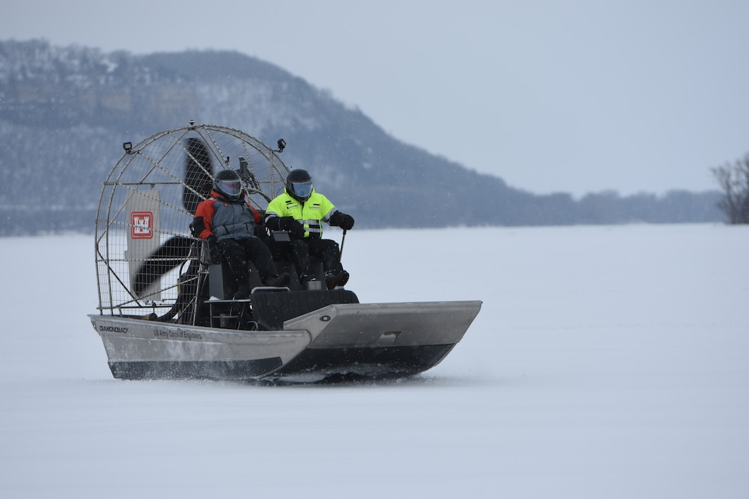 Survey team collects ice thickness on an air boat
