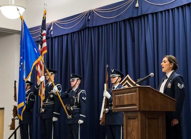 Staff Sgt. Alicia Garcia, 436th Force Support Squadron Airman Leadership School instructor, sings the national anthem during the Chief Master Sergeant Recognition Ceremony at the Landings, Feb. 8, 2020, on Dover Air Force Base, Del. The Dover Air Force Base Honor Guard posted the colors at the beginning of the ceremony. (U.S. Air Force photo by Roland Balik)