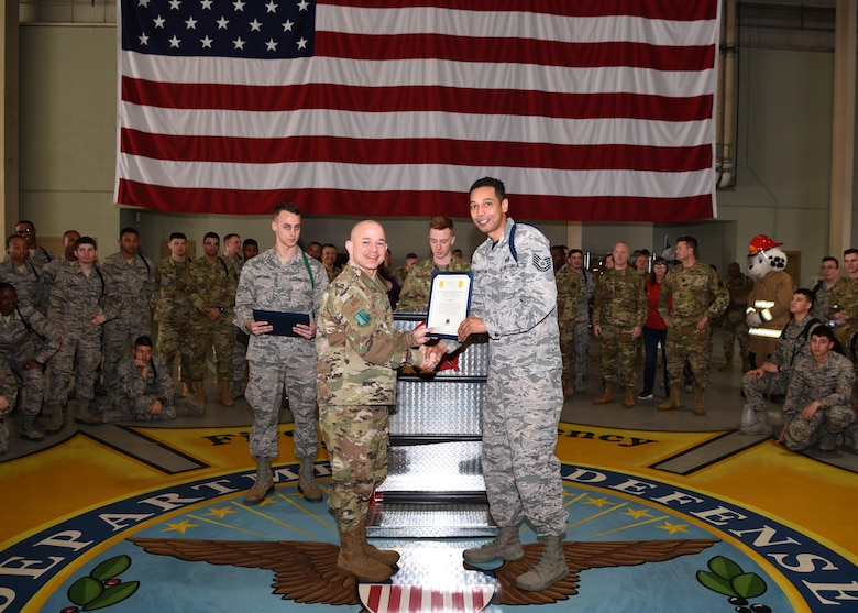U.S. Air Force Col. Andres Nazario, 17th Training Wing commander, awards Tech. Sgt. Joseph Washington, 315th Training Squadron assistant flight chief and military training leader, as a Master MTL in the Louis F. Garland Department of Defense Fire Academy High Bay on Goodfellow Air Force Base, Texas, Feb. 7, 2020. As the first Master MTL position in the Air Education and Training Command history, new position comes with a higher standard to mentor, train and lead. (U.S. Air Force photo by Airman 1st Class Abbey Rieves)