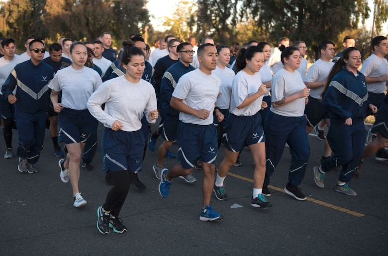 Airmen participate in a group fitness exercise.