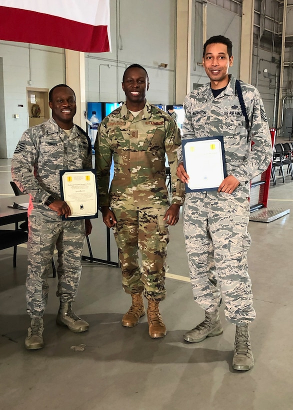 U.S. Air Force Tech. Sgt. Derwin Finley, 312th Training Squadron assistant flight chief and master military training leader, Chief Master Sgt. Lavor Kirkpatrick, 17th Training Wing command chief and Tech. Sgt. Joseph Washington, 315th Training Squadron assistant flight chief and master MTL pose for a congratulatory photo in the Louis F. Garland Department of Defense Fire Academy High Bay on Goodfellow Air Force Base, Texas, Feb. 7, 2020.  Finley and Washington became the first Master Military Training Leaders in the Air Education and Training Command. (Courtesy photo)