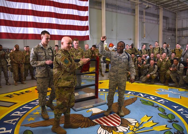 U.S. Air Force Col. Andres Nazario, 17th Training Wing commander, recognizes Tech. Sgt. Derwin Finley, 312th Training Squadron assistant flight chief and military training leader, as the winner of the Master MTL Program in the Louis F. Garland Department of Defense Fire Academy High Bay on Goodfellow Air Force Base, Texas, Feb. 7, 2020. Finley earned the first Master MTL position in the Air Education and Training Command history.  (U.S. Air Force photo by Airman 1st Class Abbey Rieves)
