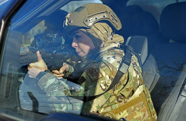 Technical Sgt. Jessica Vizcaino, 100th Security Forces Squadron flight chief, checks and clears a vehicle-borne improvised explosive device scene during a readiness exercise at RAF Mildenhall, England, Feb. 11, 2020. The main purpose of the exercise was to demonstrate how rapidly Bloody Hundredth Airmen are able to organize an entire wing and deal with simulated real-world scenarios. (U.S. Air Force photo by Senior Airman Brandon Esau)