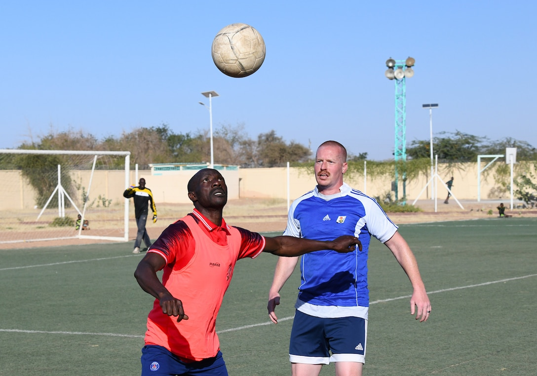 Photo of U.S. military and local team playing soccer.