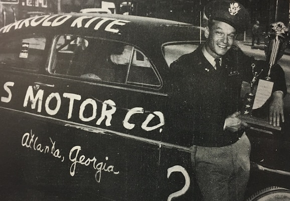 Capt. Harold Kite of the Georgia Army National Guard poses with his 1949 Lincoln and victory trophy from the 1950 Daytona stock car race. Kite, who commanded the Atlanta-based 201st Ordnance Medium Maintenance Company, won the race with a record time of 2 hours, 26 minutes, 30 seconds.