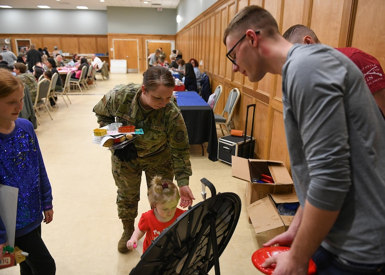 Airmen come together for a deployed family dinner social event