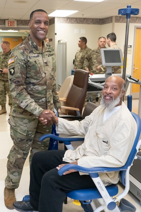 Army Brig. Gen. Gavin Lawrence, DLA Troop Support Command, shakes hands with a veteran patient at the Corporal Michael J. Crescenz Veterans Affairs Medical Center, Feb. 10, 2020 in Philadelphia.