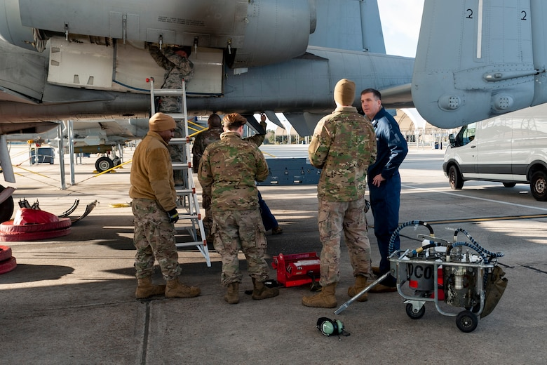 Photo of Airmen explaining inspection procedures to Col. Walls