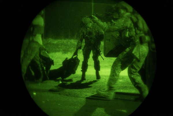 Airmen from the 148th Air Support Operations Squadron, Pennsylvania Air National Guard, perform a casualty evacuation drill during training Jan. 11, 2020, in Annville, Pennsylvania. The 148th ASOS performed a round-robin style training event, conducting tactical drills at night.