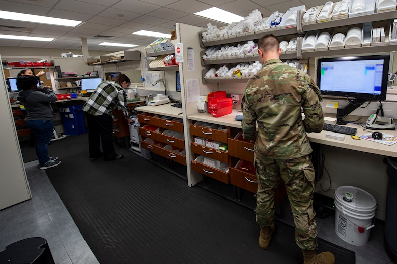 Photo of pharmacy technicians assigned to the 23d Medical Support Squadron processing prescriptions.