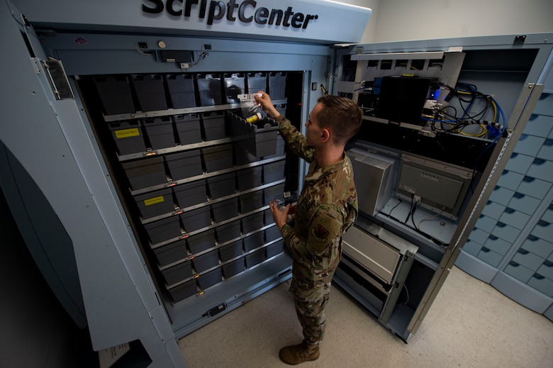 Photo of an Airman delivering prescriptions to the ScriptCenter.
