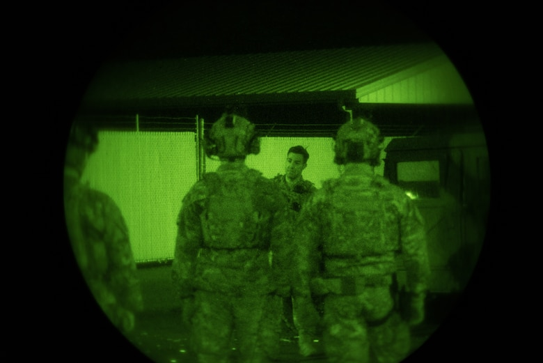 Tactical Air Control Party specialists from the 148th Air Operations Squadron perform night-time training.