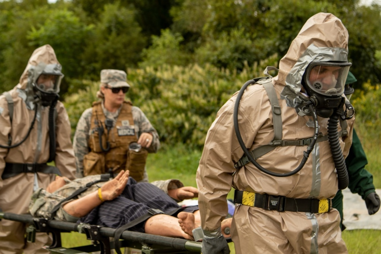 Soldiers evacuate a patient during a training exercise.