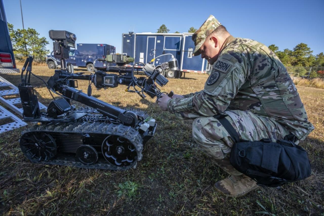 Soldier checks a robot..