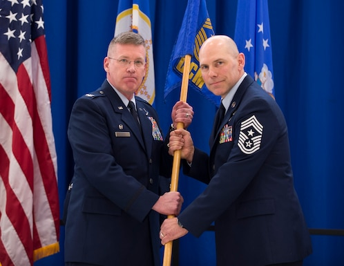 U.S. Air Force Chief Master Sgt. Mark Legvold receives the duties of Command Chief Master Sgt. of the 133rd Airlift Wing from Col. James Cleet, Commander of the 133rd Airlift Wing in St. Paul, Minn., Feb. 9, 2020.