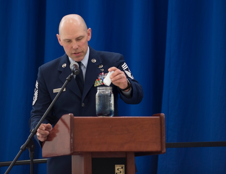 U.S. Air Force Command Chief Master Sgt. Mark Legvold, 133rd Airlift Wing, puts blue drops into a jar of water in St. Paul, Minn., Feb. 9, 2020.