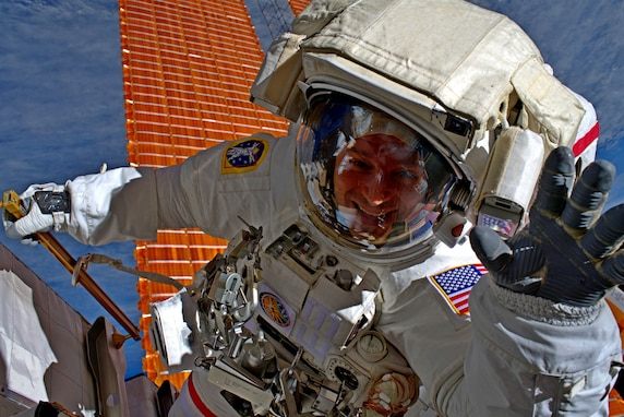 Army astronaut, Col. Andrew Morgan waves in space.