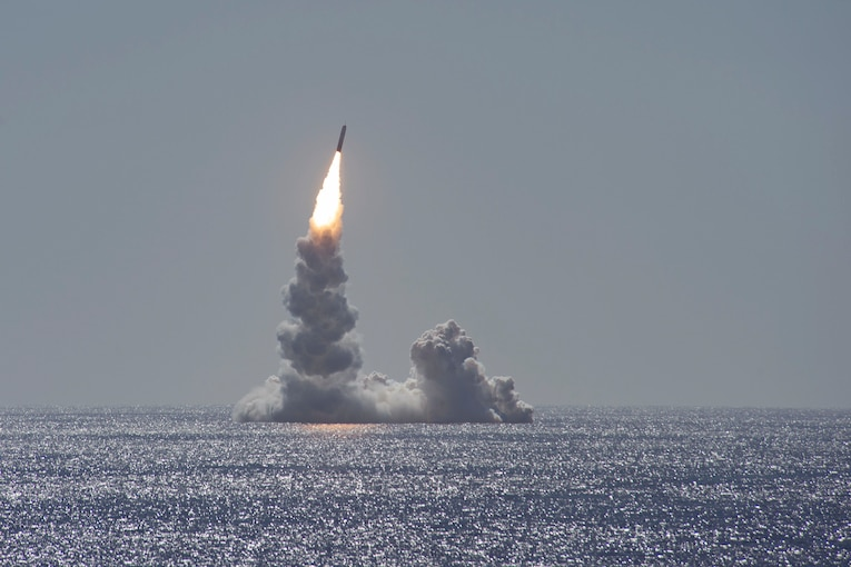 A missile is launched from a submarine.