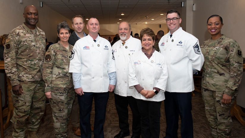 Sheppard Air Force Base leadership and force support squadron leadership pose with Hennessy Award evaluators at Sheppard AFB, Texas, Feb. 7, 2020. Sheppard has won three previous Hennessy Awards for their above and beyond dining facility operations. The Hennessy team is here to evaluate, giving Sheppard a chance for four wins. (U.S. Air Force photo by Senior Airman Pedro Tenorio)