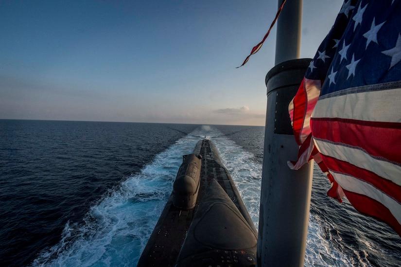 Sub cuts through water