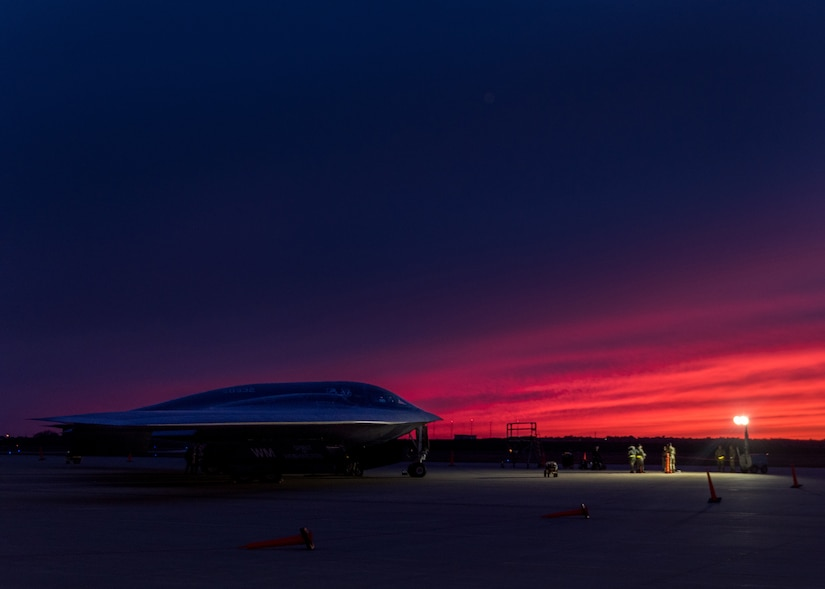 Jet sits on runway in near darkness