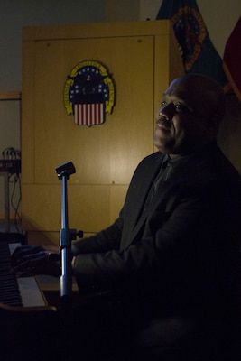 Joseph Patterson, Key Arts Productions entertainer, plays the piano during a multimedia presentation at the African American History Month event Feb. 12 in Philadelphia. The event celebrated African Americans through a multimedia presentation that included video, slideshows, narration and live music.