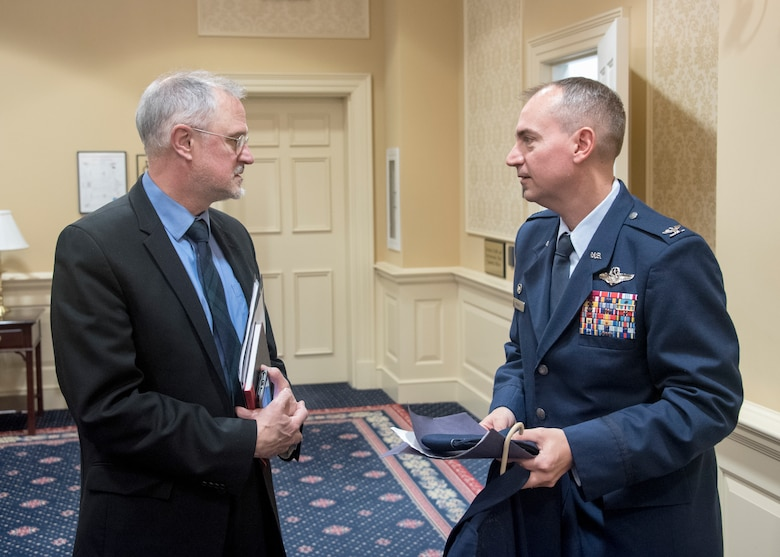 Marcus J. Beauregard, Defense-State Liaison Office director, speaks with Col. Andrew Purath, 11th Wing and Joint Base Andrews Commander, after testifying on Senate Bill 280 at the Education, Health and Environmental Affairs Committee hearing in Annapolis, Md., Feb. 6, 2020. Senate Bill, Occupational and Professional Licensing - Service Members, Veterans, and Military Spouses - Revisions to Reciprocity Requirements, allows for a permanent solution to service members, veterans, and military spouse with out-of-state licenses who wish to work in the Maryland. This bill is a part of the Defense-State Liaison Office's plan to eliminate the Barriers to license portability experience by military spouses. (U.S. Air Force photo by Staff Sgt. Jared Duhon)