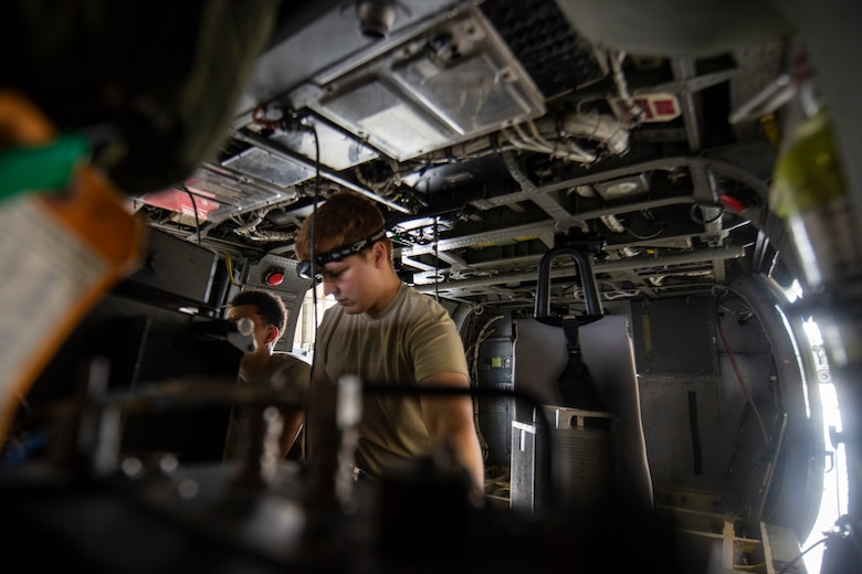 A photo of an Airman checking a helicopter