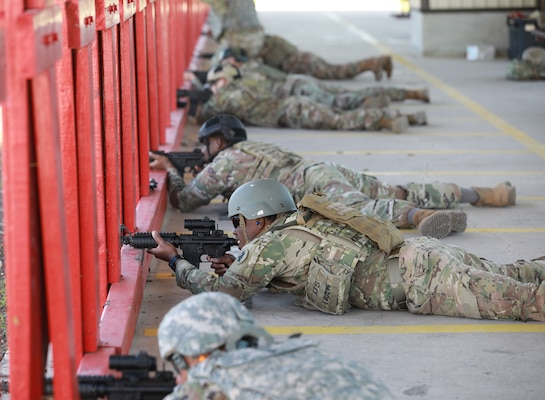 soldiers shooting rifles