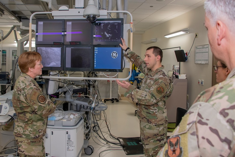 U.S. Air Force Master Sgt. Trey Garner, center, 60th Medical Group cardiology services manager provides an overview of a cardio suite while Lt. Gen. Dorothy Hogg, left, Air Force Surgeon General, looks on during a tour through the Heart,  Lung and Vascular Center, David Grant USAF Medical Center at Travis Air Force Base, California, Feb. 10, 2020. Hogg visited with 60th Medical Group Airmen and recognized the positive impact they have on their community through their innovative medical practices. (U.S. Air Force photo by Heide Couch