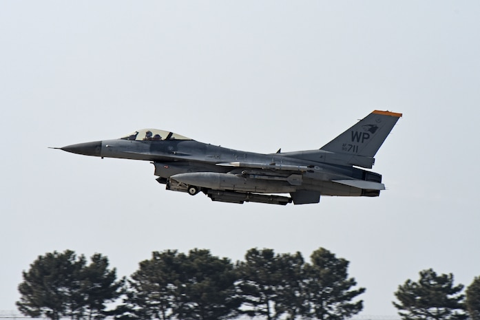 "A U.S. Air Force F-16 Fighting Falcon assigned to the 80th Fighter Squadron ""Juvats"" takes off for a routine training flight at Kunsan Air Base, Republic of Korea, Feb. 11, 2020. The 80th FS is one of two fighter squadrons assigned to the 8th Fighter Wing. The squadron was activated during World War II in 1942, as the 80th Pursuit Squadron. (U.S. Air Force photo by Staff Sgt. Mackenzie Mendez)"