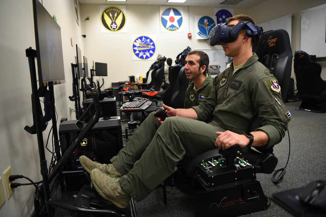 Second Lt. Matthew Demarco, 14th Student Squadron student pilot, operates the virtual reality flight simulation equipment while Lt. Col. Christopher Harris, 41st Flying Training Squadron chief pilot and director of innovation flight, instructs him Feb. 11, 2020, on Columbus Air Force Base, Miss. In the VR simulation students can practice everything from starting up the aircraft to landing it. The ability to use VR tools extends the students familiarity with the aircraft they are going to fly before they step foot in it. (U.S. Air Force photo by Airman 1st Class Jake Jacobsen)