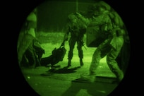 U.S. Airmen from the 148th Air Support Operations Squadron perform a casualty evacuation drill during night-time training