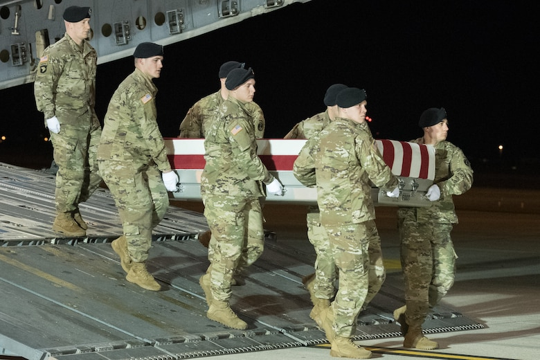 A U.S. Army carry team transfers the remains of Spc. Branden T. Kimball, of Central Point, Ore., Feb. 14, 2020 at Dover Air Force Base, Del. Kimball was assigned to 3rd Battalion, 10th Aviation Regiment, 10th Combat Aviation Brigade, Fort Drum, N.Y. (U.S. Air Force Photo by Mauricio Campino)