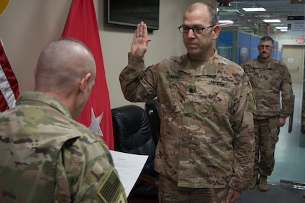 Ohio National Guard Lt. Col. Matt Crawford, deployed as the protection chief in support of Operation Spartan Shield in the Middle East, is sworn in for his next term as veterans service commissioner by Maj. Gen. Gordon L. Ellis, 38th Infantry Division commanding general, Jan. 17, 2020.