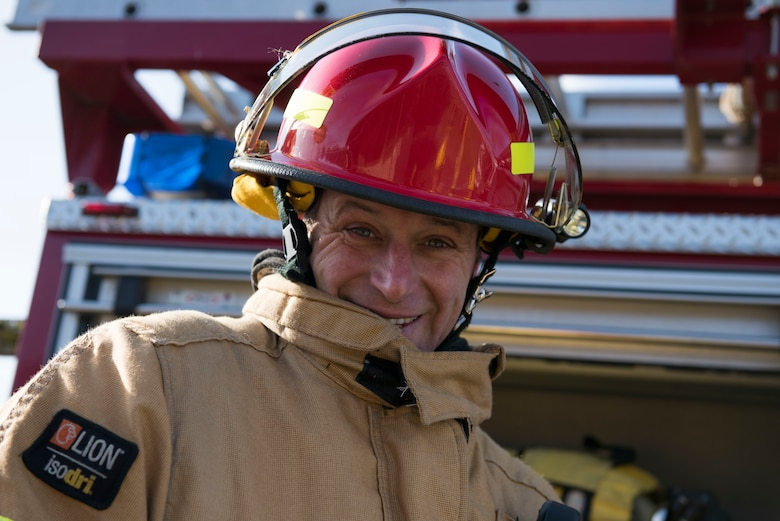 Duncan Fossey, 422nd Civil Engineer Squadron firefighter crew chief, smiles into the camera during the 501st Combat Support Wing Readiness Exercise 20-01 at RAF Croughton, England, Feb. 12, 2020. The exercise tested the wing's preparedness and response capabilities to an emergency situation. (U.S. Air Force photo by Airman 1st Class Jennifer Zima)
