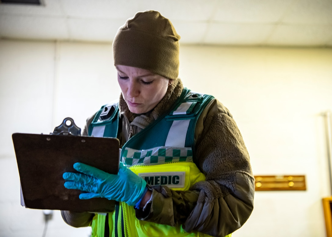 Tech Sgt. Brittani McClure, 423d Medical Squadron aerospace medical technician, writes down notes during a readiness exercise at RAF Molesworth, England, Feb. 11, 2020.  The exercise tested the wing's preparedness and response capabilities to an emergency situation. (U.S. Air Force photo by Senior Airman Eugene Oliver)