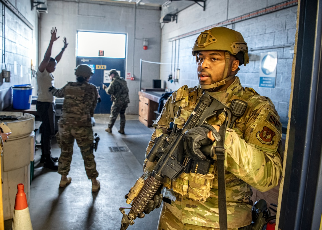 Senior Airman Denzel Hughes, (right) 423d Security Forces Squadron patrolman, secures the area as Airmen from the 423d SFS ensure the safety of simulated victims during a readiness exercise, at RAF Molesworth, England, Feb. 11, 2020. The exercise tested the wing's preparedness and response capabilities to an emergency situation. (U.S. Air Force photo by Senior Airman Eugene Oliver)